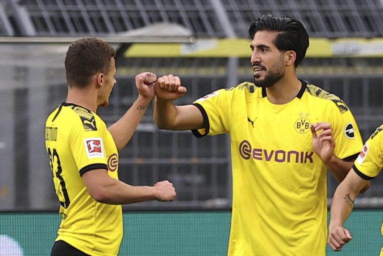 Dortmund players celebrate a goal against Hertha Berlin