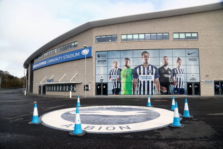 Fans will be conspicuous by their absence when Arsenal visit the AMEX Stadium.