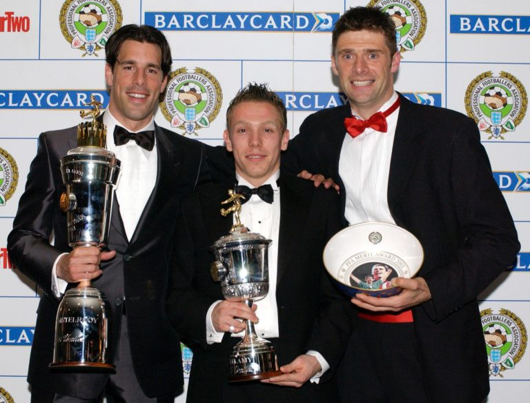 Ruud van Nistelrooy (left) with the Professional Footballers Association Player of the Year trophy