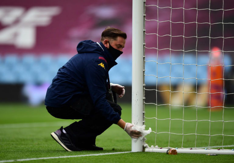 Goal posts are wiped clean with a disinfectant wipe ahead of the match at Villa Park