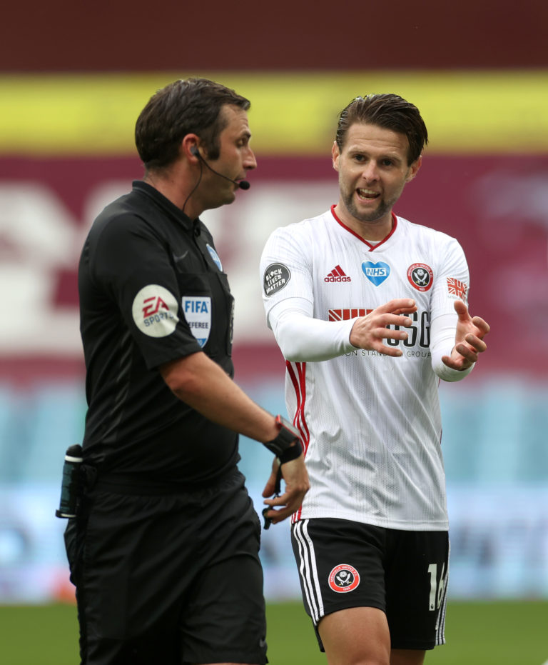 Michael Oliver, left, discusses the goal-line incident with Sheffield United's Oliver Norwood