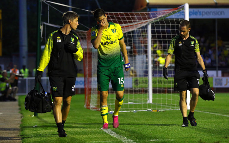 Norwich's Timm Klose walks off after picking up an injury during the Carabao Cup second round match at Crawley