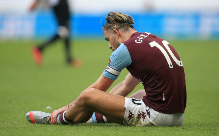 Aston Villa's Jack Grealish sits dejected after the match