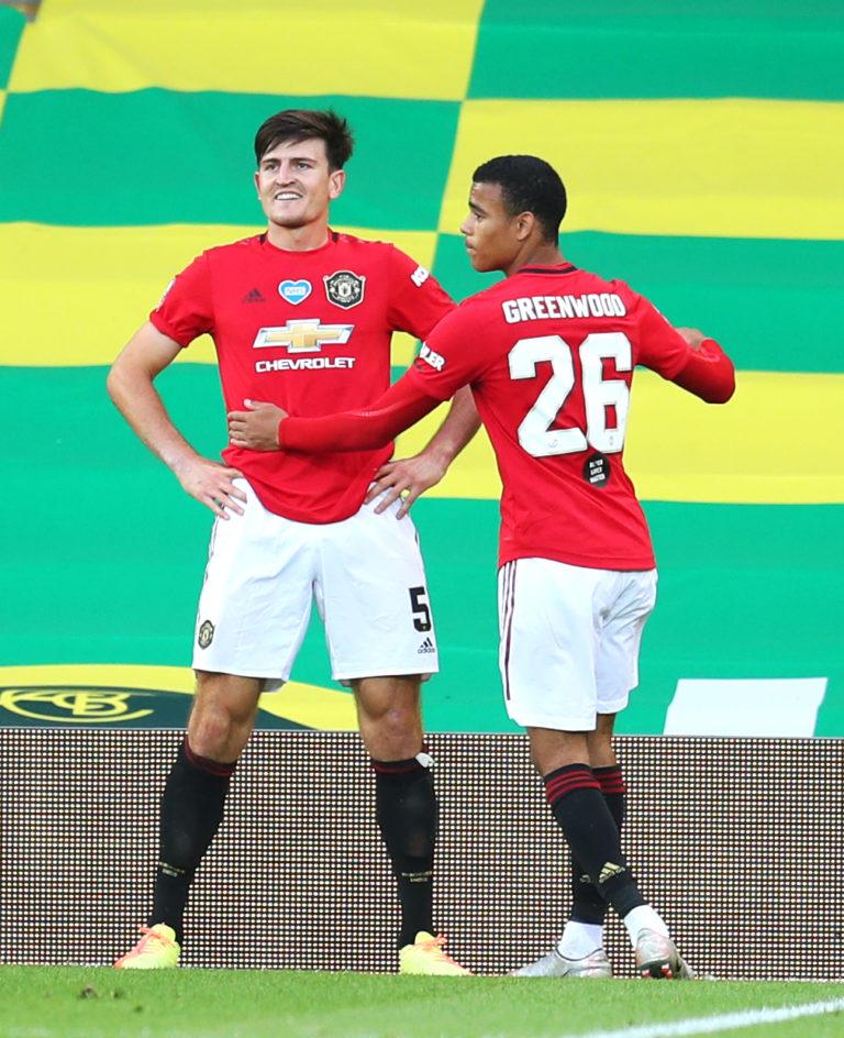 Harry Maguire (left) celebrates with Mason Greenwood