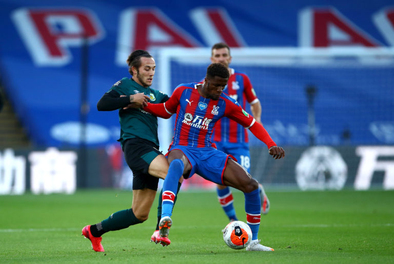 Josh Brownhill, left, and Crystal Palace's Wilfried Zaha battle for the ball