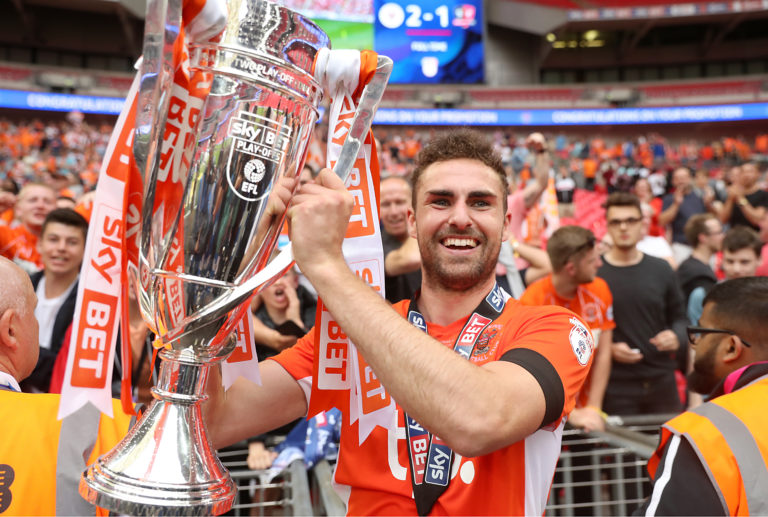 Blackpool's Clark Robertson celebrates with the trophy