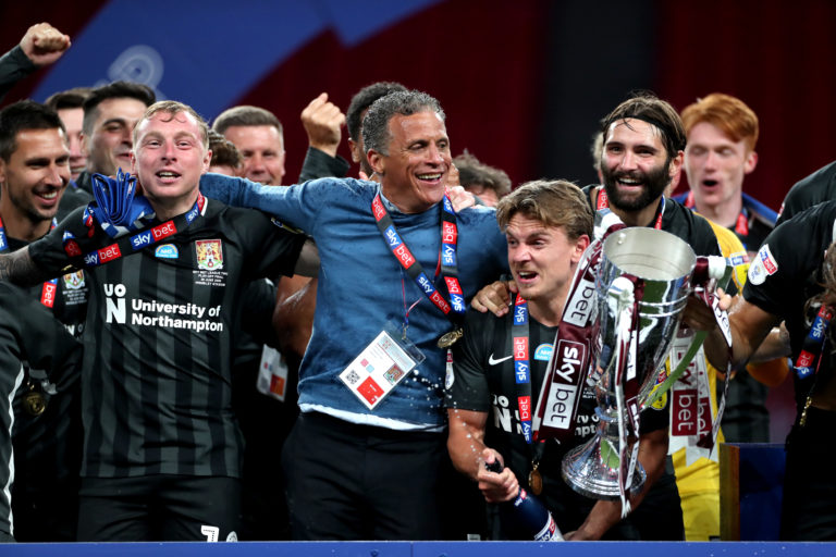 Northampton boss Keith Curle celebrated the first promotion of his managerial career
