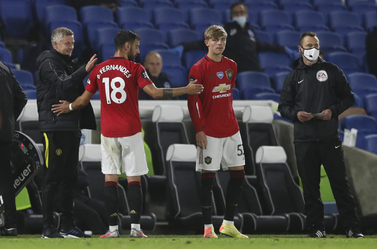 Manchester United manager Ole Gunnar Solskjaer congratulates Bruno Fernandes as he is substituted