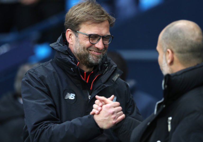 Guardiola (right) and Klopp (left) have a friendly rivalry