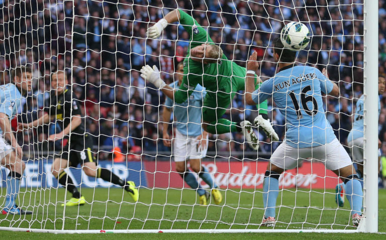 Ben Watson, second left, celebrates his winning goal for Wigan against Manchester City in the 2013 FA Cup final