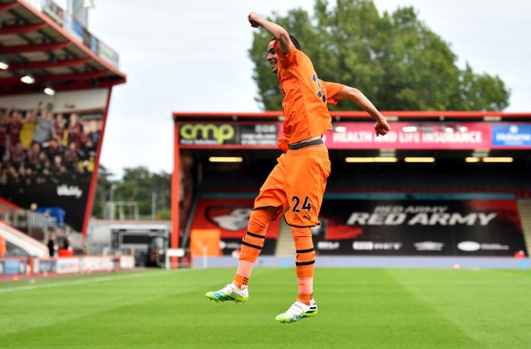 Miguel Almiron celebrates scoring his side's third goal