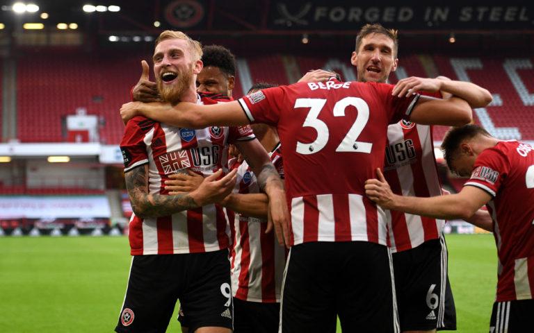 Oli McBurnie celebrates scoring Sheffield United's third goal