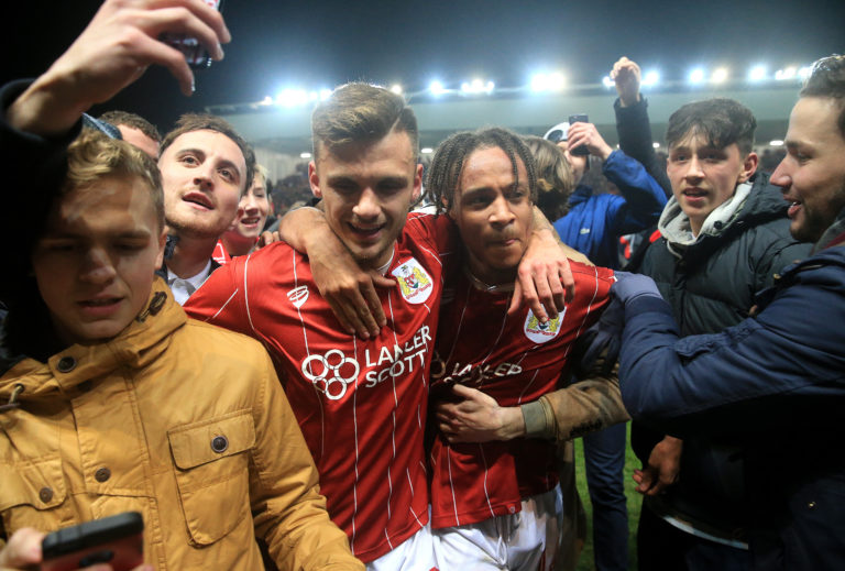Bristol City's Jamie Paterson (left) and Bobby Reid celebrate after the win against Manchester United