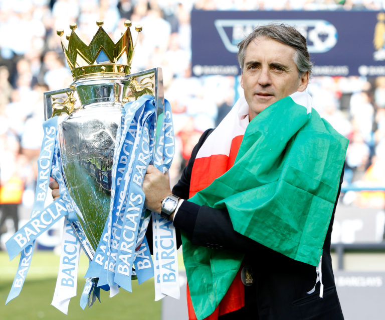 City manager Roberto Mancini signed the new deal after leading the club to the title in 2012