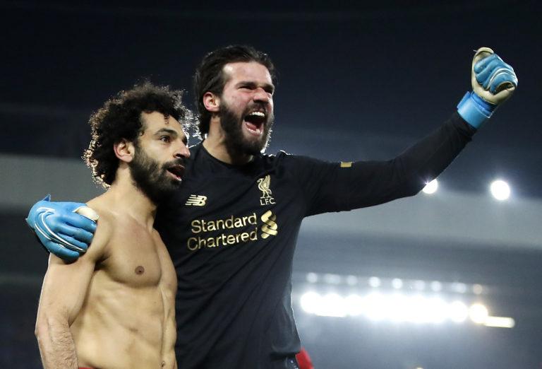 Liverpool goalkeeper Alisson Becker, right, says Mohamed Salah is