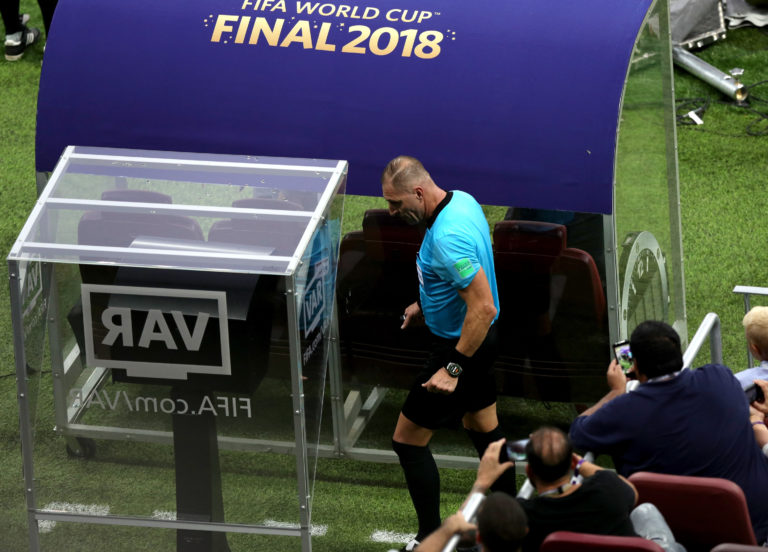 Nestor Pitana checks the pitchside monitor during the 2018 World Cup final