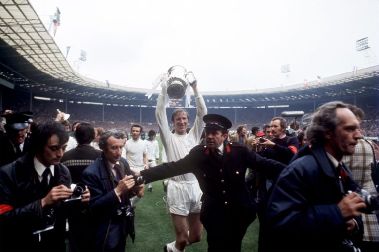 Jack Charlton celebrates with the FA Cup after Leeds' victory in 1972