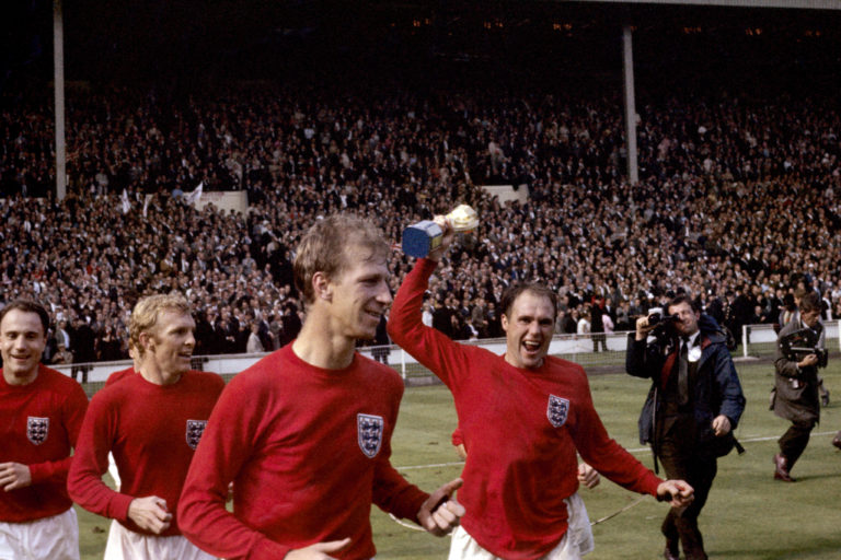 England's George Cohen, Bobby Moore, Jack Charlton and Ray Wilson, with trophy, celebrate after winning the World Cup in 1966