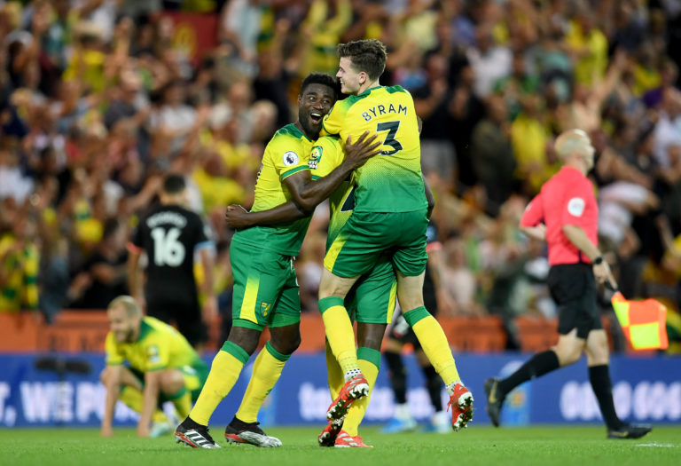 Norwich celebrate their victory over Manchester City