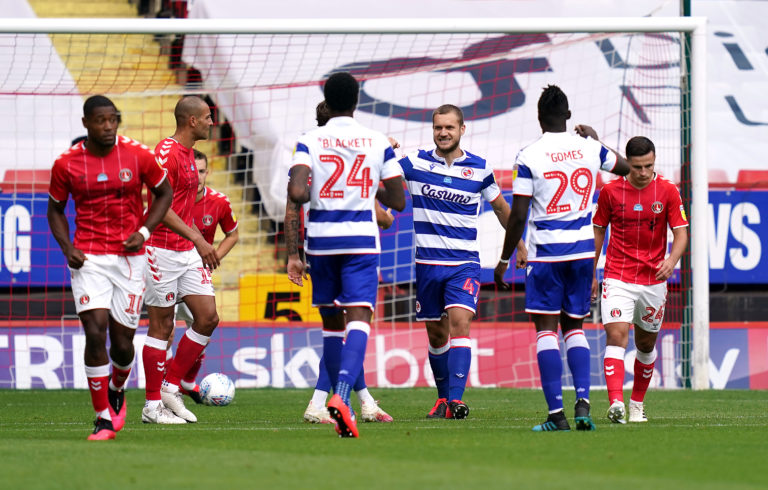Reading's George Puscas, centre, netted from the penalty spot at Charlton