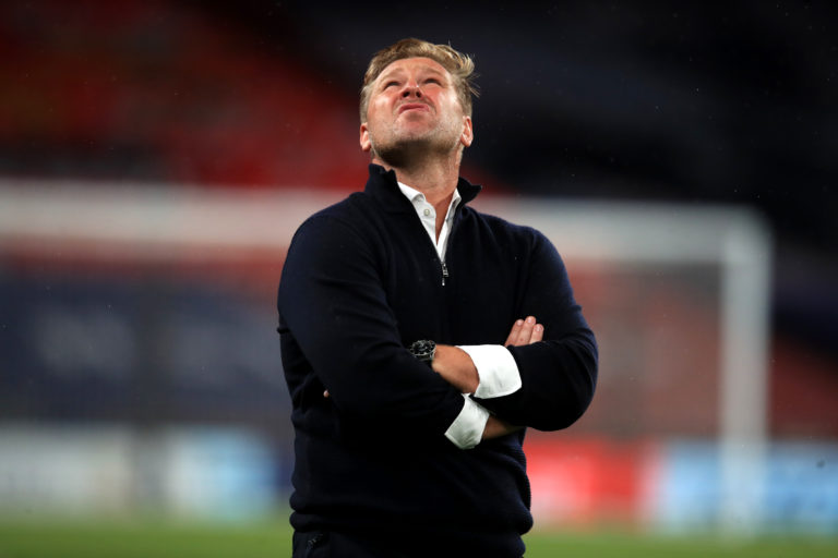 Karl Robinson shows his frustration after defeat at Wembley