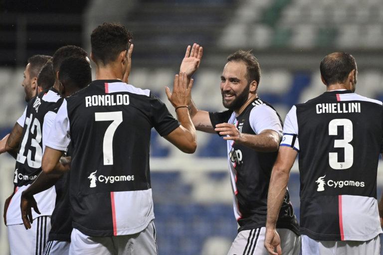 Gonzalo Higuain, second right, put Juventus 2-0 ahead against Sassuolo