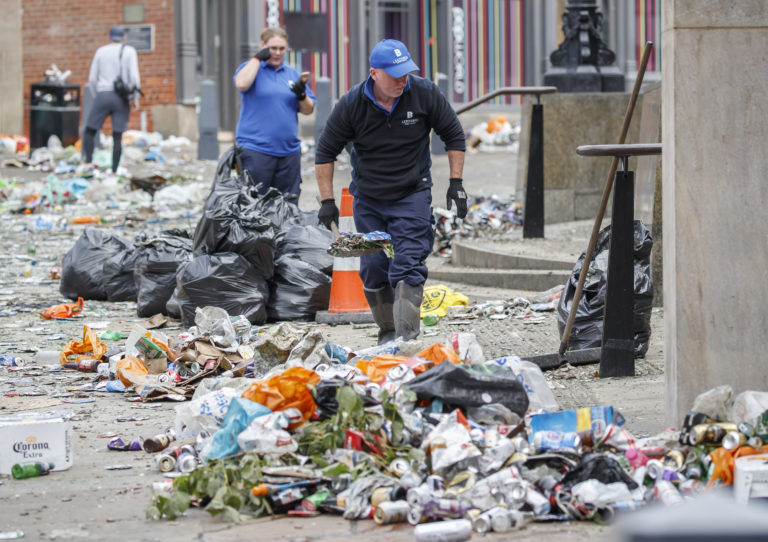 Workers clear litter in the centre of Leeds after celebrations by fans whose football club won the Championship title and a return to the Premier League
