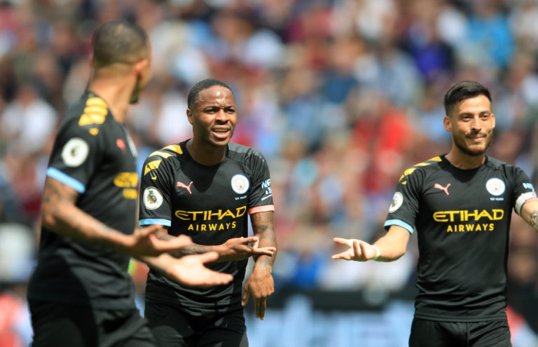 Raheem Sterling, centre, leads the protestations after VAR made its mark in the Premier League for the first time. Sterling's hat-trick helped get the reigning champions' title defence off to a flying start in a 5-0 success at West Ham but City were denied another goal when, on review, he was ruled offside by a matter of millimetres having assisted fellow forward Gabriel Jesus, left