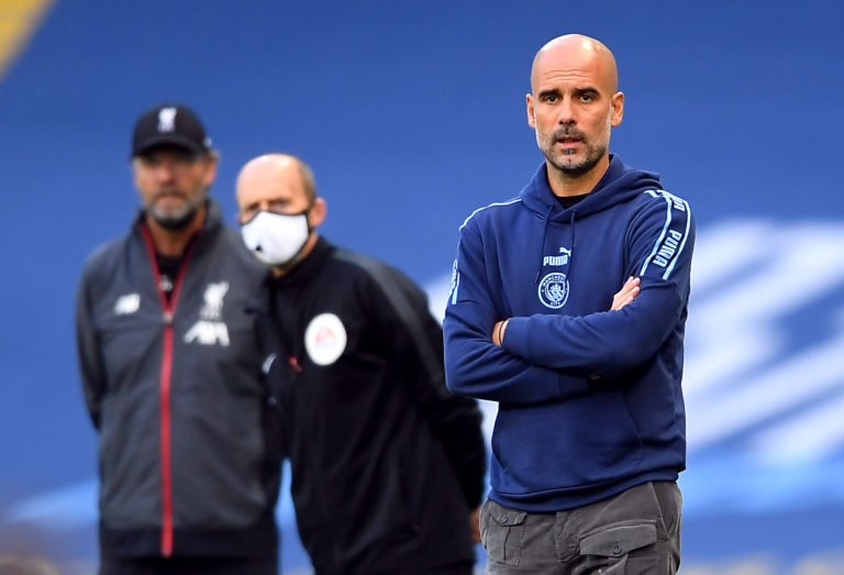 Masked fourth official Mike Dean, centre, peers past Pep Guardiola during Manchester City's thrashing of champions Liverpool. City gave Jurgen Klopp's Reds a belated reminder of their power as they thrashed their newly-crowned successors 4-0 at the Etihad Stadium in early July