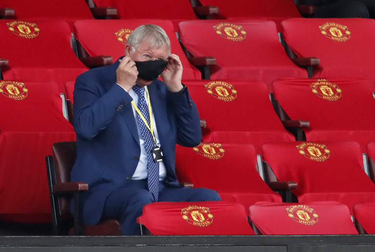 Former Manchester United Sir Alex Ferguson adjusts his face mask at Old Trafford. The 78-year-old watched from the stands as United ... against West Ham
