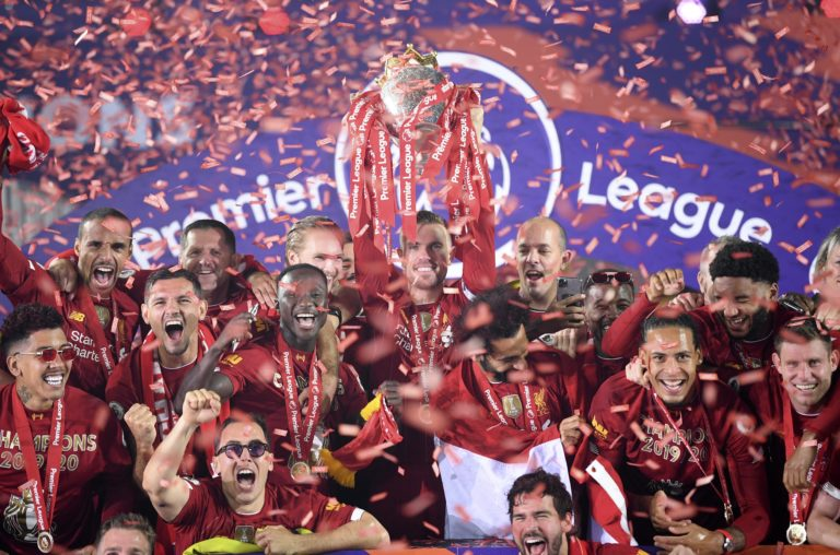 Liverpool captain Jordan Henderson lifts the Premier League trophy after an entertaining 5-3 win over Chelsea. Henderson became the first Reds skipper in 30 years to lead the club to the title. Jurgen Klopp's men celebrated wildly at an empty Anfield as coronavirus restrictions prevented supporters from attending the presentation ceremony