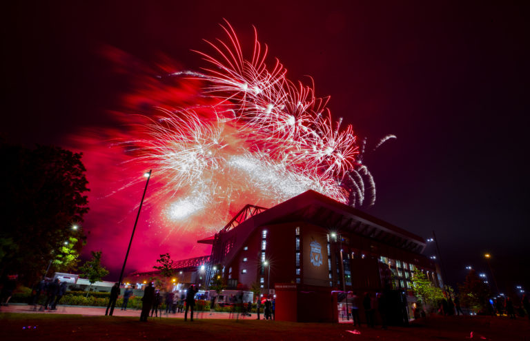 Fireworks light up the night sky above Anfield Stadium as Liverpool lift the Premier League trophy. Despite being urged to stay at home by the club, a number of Reds fans turned up at the stadium to savour a memorable moment