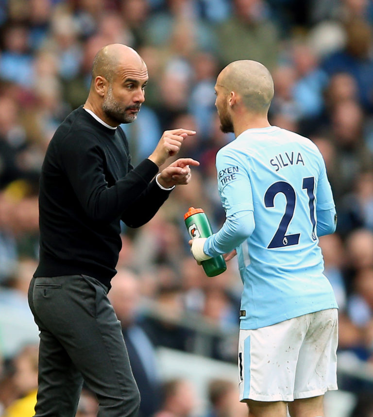 Silva (right) has thrived under Pep Guardiola (left)
