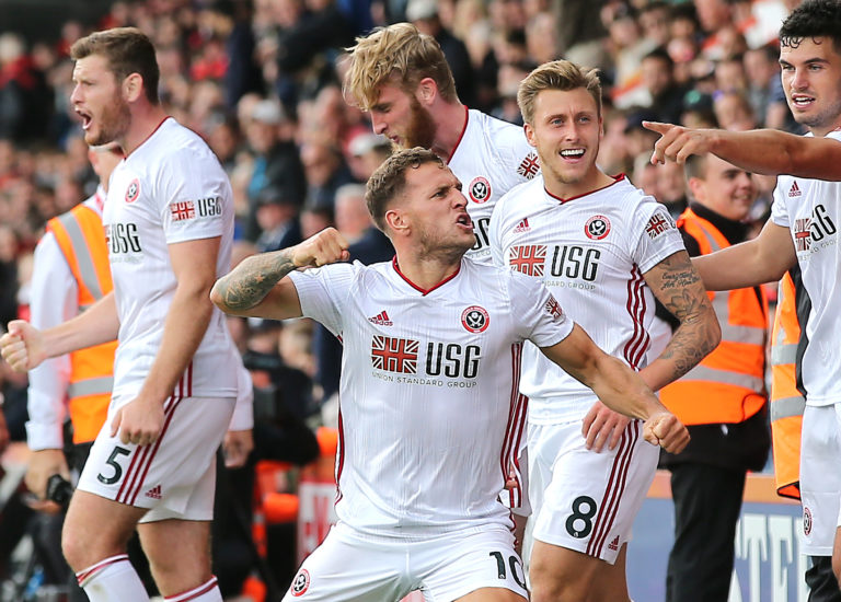 Sheffield United captain Billy Sharp, centre, celebrates wildly after stepping off the bench to grab a late equaliser at Bournemouth on the opening weekend. Chris Wilder's newly-promoted Blades enjoyed a season to remember, securing a top-half finish in their first Premier League campaign since 2006-07