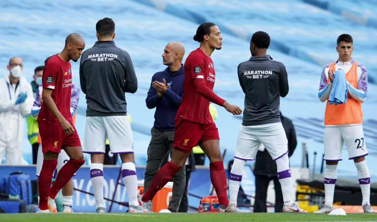 Liverpool are given a guard of honour by former champions Manchester City. The Reds arrived at the Etihad Stadium with the title sewn up after City lost 2-1 at Chelsea in their previous league match. Virgil Van Dijk and Fabinho, pictured, had endured an evening to forget as Pep Guardiola's hosts exacted a modicum of revenge with a thumping 4-0 success