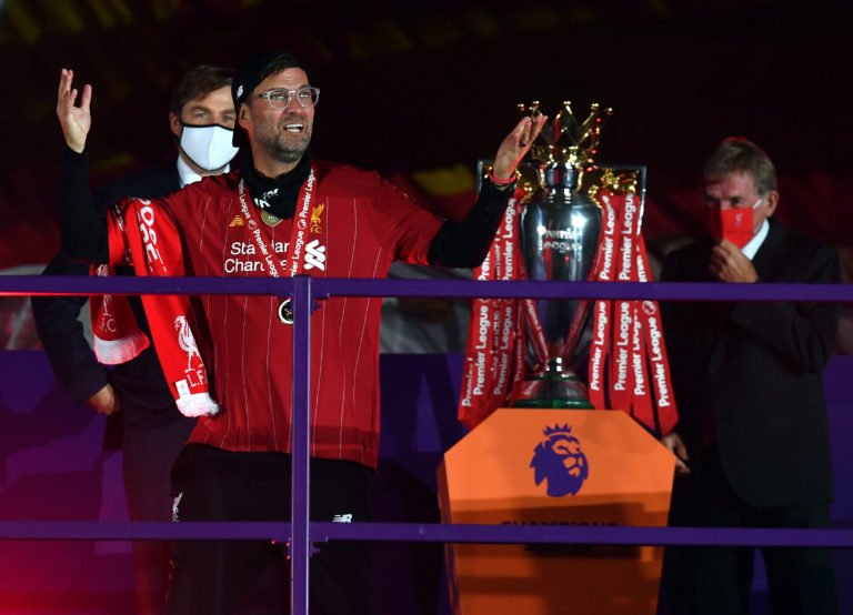 Liverpool manager Jurgen Klopp revels in his success after receiving a Premier League winners' medal. The German became the first title-winning Reds boss since Kenny Dalglish. Club great Dalglish right, was at Anfield as part of the presentation ceremony, sporting a red face mask